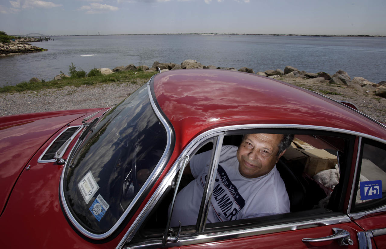 ***HOLD FOR FAY ABUELGASIM STORY*** Irv Gordon poses for a picture in his Volvo P1800 in Babylon, N.Y., Monday, July 2, 2012. Gordon's car already holds the world record for the highest recorded milage on a car and he is less than 40,000 miles away from passing three million miles on the Volvo. (AP Photo/Seth Wenig)
