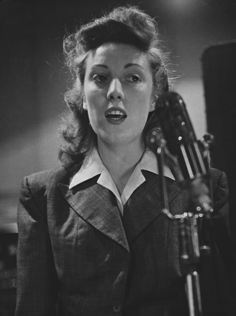 English singer Vera Lynn singing during a broadcast to Allied troop during WWII. (Photo by © Hulton-Deutsch Collection/CORBIS/Corbis via Getty Images)