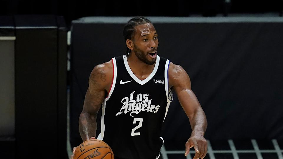 Los Angeles Clippers forward Kawhi Leonard (2) controls the ball during Game 7 of an NBA basketball first-round playoff series against the Dallas Mavericks Sunday, June 6, 2021, in Los Angeles, Calif. (AP Photo/Ashley Landis)