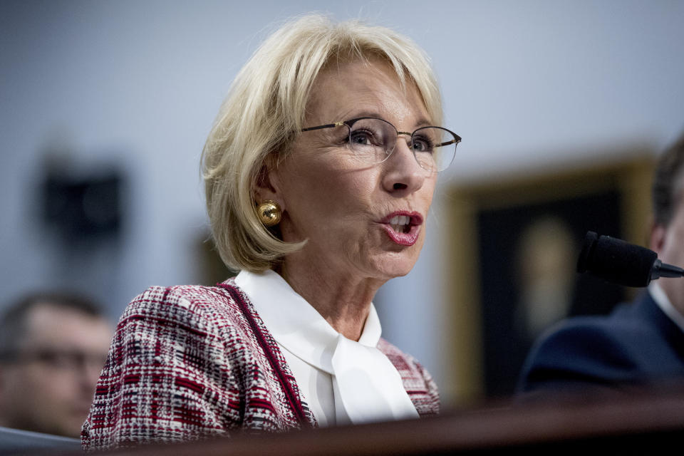 FILE - In this March 26, 2019 file photo, Education Secretary Betsy DeVos speaks during a House Appropriations subcommittee hearing on Capitol Hill in Washington.   The Education Department is fining Michigan State University $4.5 million for failing to respond to sexual assault complaints against Dr. Larry Nassar.  The announcement was made Thursday by Education Secretary Betsy DeVos. (AP Photo/Andrew Harnik)