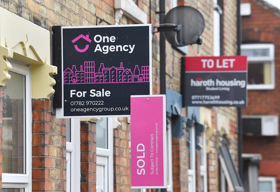 STOKE-ON-TRENT, ENGLAND - MARCH 03: Placards from Once Agency estates agents advertising properties For Sale and Sold on March 03, 2021 in Stoke-on-Trent, England. UK Chancellor, Rishi Sunak, announced the return of 95% mortgages to help first-time buyers. He also announced that house buyers would be exempt from paying stamp duty for a further three months with the scheme ending on 31st June 2021. (Photo by Nathan Stirk/Getty Images)
