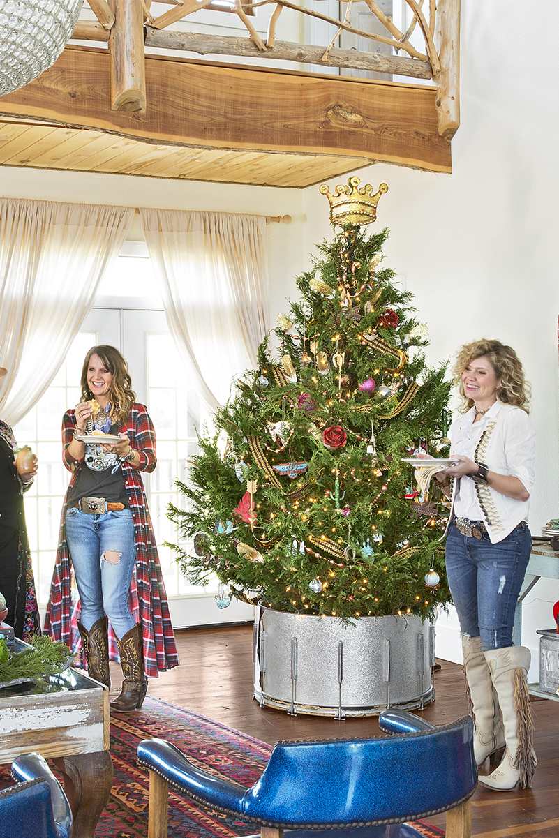 "<p>The <a href=""https://www.countryliving.com/home-design/house-tours/g4931/junk-gypsies-texas-inn/"" rel=""nofollow noopener"" target=""_blank"" data-ylk=""slk:Junk Gypsies placed their tree"" class=""link rapid-noclick-resp"">Junk Gypsies placed their tree</a> in a bass drum discovered at a thrift store. Genius! </p><p><a class=""link rapid-noclick-resp"" href=""https://www.amazon.com/s?k=artificial+christmas+trees&ref=nb_sb_noss&tag=syn-yahoo-20&ascsubtag=%5Bartid%7C10050.g.28746492%5Bsrc%7Cyahoo-us"" rel=""nofollow noopener"" target=""_blank"" data-ylk=""slk:SHOP ARTIFICIAL TREES"">SHOP ARTIFICIAL TREES</a></p>"