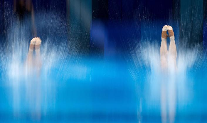 <p>China's Xie Siyi and China's Wang Zongyuan compete in the men's synchronized 3m springboard diving final event on July 28.</p>