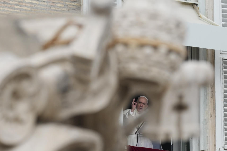 Pope Francis delivers his blessing during the Angelus noon prayer from the window of his studio overlooking St.Peter's Square, at the Vatican, Sunday, Oct. 3, 2021. (AP Photo/Alessandra Tarantino)