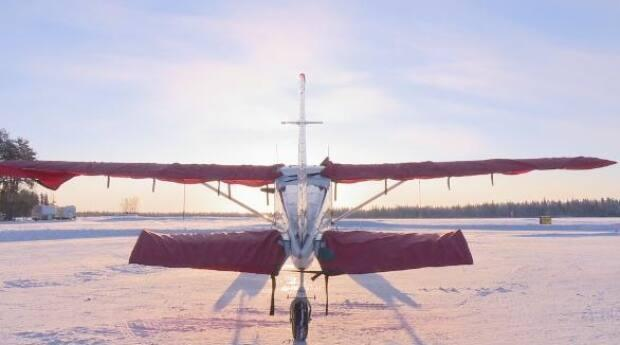 A plane at the Fort Smith Airport in January. Transport Canada is providing more than $15 million for work at that facility, with additional money for the Fort Simpson and Yellowknife airports. (Anna Desmarais/CBC - image credit)