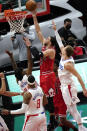 Chicago Bulls guard Zach LaVine (8) drives to the basket against Los Angeles Clippers guard Terance Mann, left, forward Marcus Morris Sr., (8) and guard Luke Kennard during the second half of an NBA basketball game in Chicago, Friday, Feb. 12, 2021. (AP Photo/Nam Y. Huh)