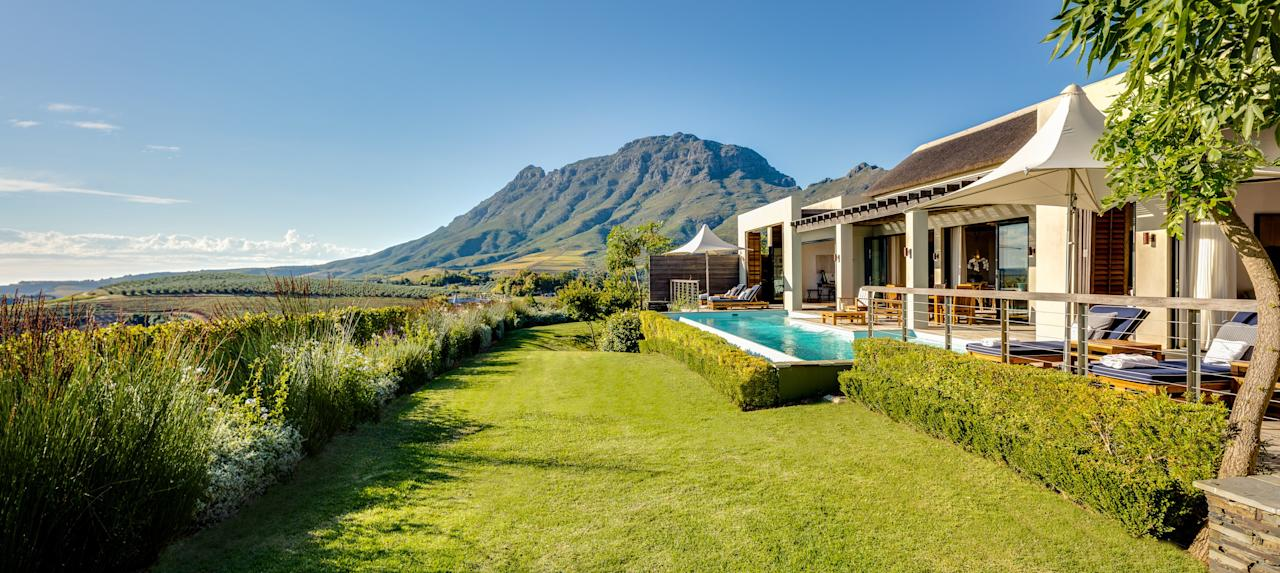 "When diamond magnate Laurence Graff visits his luxury hotel in the Cape Winelands for two weeks every December, he stays in the Owner's Lodge. (Bono has also been a guest.) The 1,400-square-foot lodge is the largest on the Relais & Châteaux property—at least until the new four-bedroom villa is completed. The two-bedroom lodge has a spacious living and dining room, marble bathrooms, a butler's pantry, and a private terrace and pool with spectacular views of the vineyards and rolling hills beyond. Headboards inspired by safari tents and artwork by Mr. Graff's son lend a sense of place. <a rel=""nofollow"" href=""http://www.delaire.co.za/"">delaire.co.za</a>; from $2,817 per night"