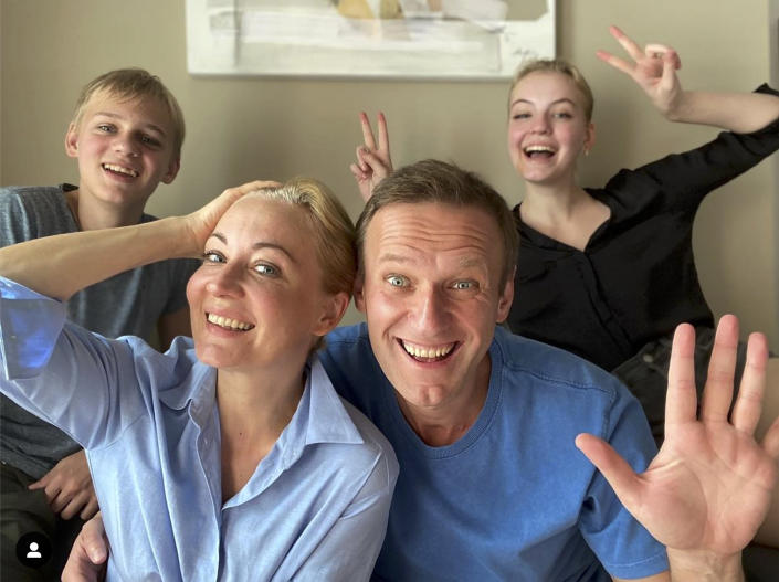 FILE - In this frame from video released on Dec. 31, 2020 by Russian opposition activist Alexei Navalny on his Instagram account, Navalny, foreground right, his wife Yulia, foreground left, his daughter Daria, right, and son Zakhar pose for a selfie. The return of Navalny from Germany on Jan. 17, 2021, after he spent five months in Berlin recovering from a nerve agent poisoning was marked by chaos and popular outrage, and it ended, almost predictably with his arrest. The flight carried him and his wife, along with a group of journalists documenting the journey. (Navalny Instagram account via AP, File)