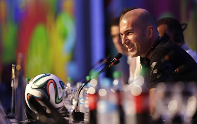 Former soccer great and World Cup winner Zinedine Zidane of France smiles during a press conference one day before the draw for the 2014 soccer World Cup in Costa do Sauipe near Salvador, Brazil, Thursday, Dec. 5, 2013. (AP Photo/Andre Penner)
