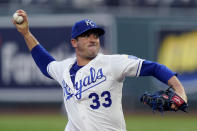 FILE - In this Sept. 1, 2020, file photo, Kansas City Royals starting pitcher Matt Harvey throws during the first inning of the team's baseball game against the Cleveland Indians in Kansas City, Mo. Harvey is back in the major leagues with the Baltimore Orioles. Baltimore selected the contract of the 31-year-old right-hander on Thursday, March 25, one week before its season opener at Boston. Harvey gets a $1 million, one-year contract.(AP Photo/Charlie Riedel, File)