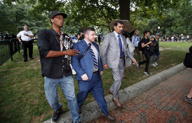 Law enforcement escorts white nationalist leader Jason Kessler from the rally near the White House. (AP Photo/Alex Brandon)