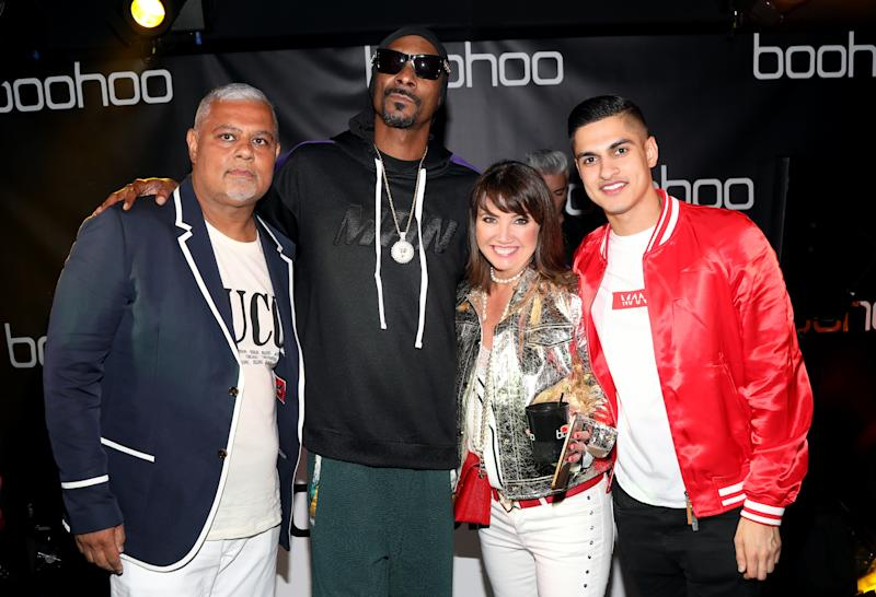 HOLLYWOOD, CA - MARCH 21: (L-R) Mahmud Kamani, Snoop Dogg Carol Kane and Samir Kamani attend the launch of the boohoo.com spring collection and the Zendaya Edit at The Highlight Room at the Dream Hollywood on March 21, 2018 in Hollywood, California. (Photo by Jerritt Clark/Getty Images for bohooo)