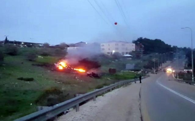 <p>In this image made from video provided by Yehunda Pinto, the wreckage of a jet is seen on fire near Harduf, northern Israel, Saturday, Feb. 10, 2018. (Photo: Yehunda Pinto via AP) </p>