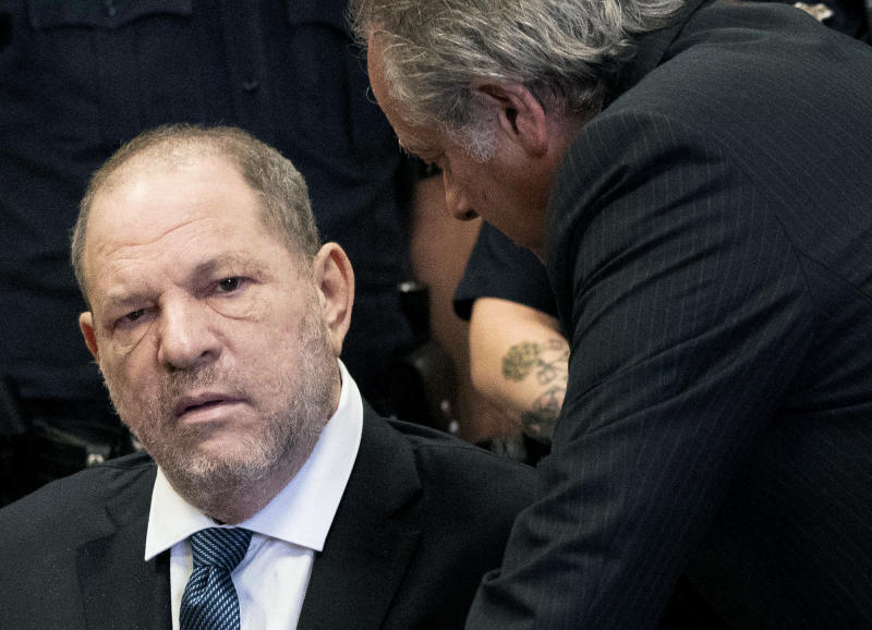 Harvey Weinstein talks with his attorney Benjamin Brafman during his hearing at a courtroom in New York, Thursday, Oct. 11, 2018. Manhattan's district attorney dropped part of the criminal sexual assault case against Weinstein on Thursday after evidence emerged that cast doubt on the account one of his three accusers provided to the grand jury. (Steven Hirsch /New York Post via AP, Pool)