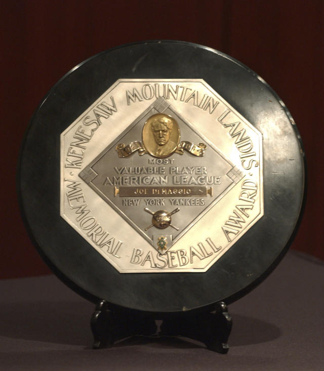 FILE - In this Jan. 22, 2006, file photo,a Joe DiMaggio 1947 MVP Award Plaque is displayed at a news conference in New York. The plaque features the name and image of Kenesaw Mountain Landis. (AP Photo/Jennifer Szymaszek, File)