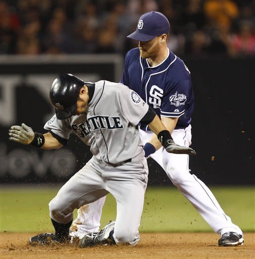 Seattle Mariners' Ichiro Suzuki bounces up from his slide while stealing second base as San Diego Padres second baseman Logan Forsythe applies alate tag during the seventh inning of a baseball game Saturday, June 23, 2012 in San Diego. (AP Photo/Lenny Ignelzi)