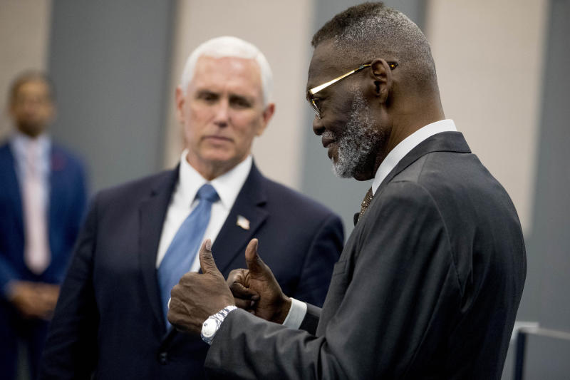 Bishop Harry Jackson gives thumbs up as he greets Vice President Mike Pence, left, who arrives to meet with community and faith leaders at Hope Christian Church, Friday, June 5, 2020, in Beltsville, Md. (AP Photo/Andrew Harnik)