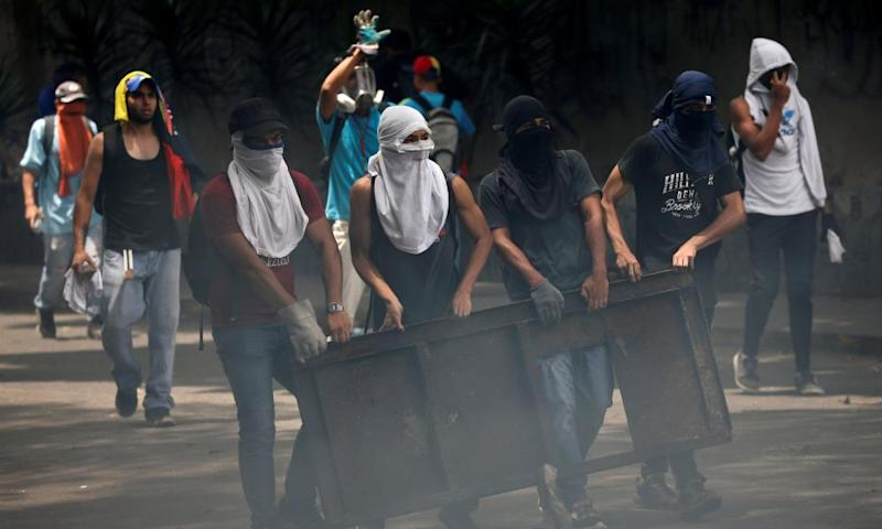 Demonstrators build a barricade while clashing with riot police during the so-called 'mother of all marches' in Caracas, Venezuela on Wednesday.