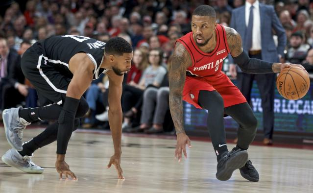 Damian Lillard was unstoppable Friday night. The rest of the Blazers, not so much. (AP Photo/Craig Mitchelldyer)