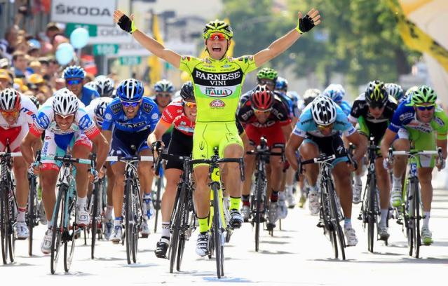 FILE PHOTO: Italy's Andrea Guardini celebrates after crossing the finish line to win the 149-km, 18th stage of the Giro d'Italia.