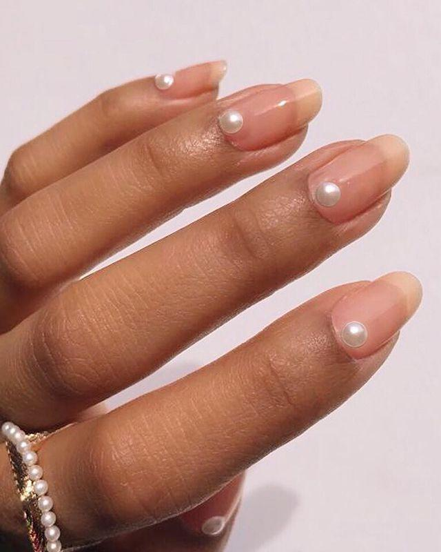"""<p>Keep your jewellery to a minimum and let your nails stand out with Nails Inc's Parisian Pearl manicure.</p><p><a href=""""https://www.instagram.com/p/Bv3WUhdpHNb/"""" rel=""""nofollow noopener"""" target=""""_blank"""" data-ylk=""""slk:See the original post on Instagram"""" class=""""link rapid-noclick-resp"""">See the original post on Instagram</a></p>"""