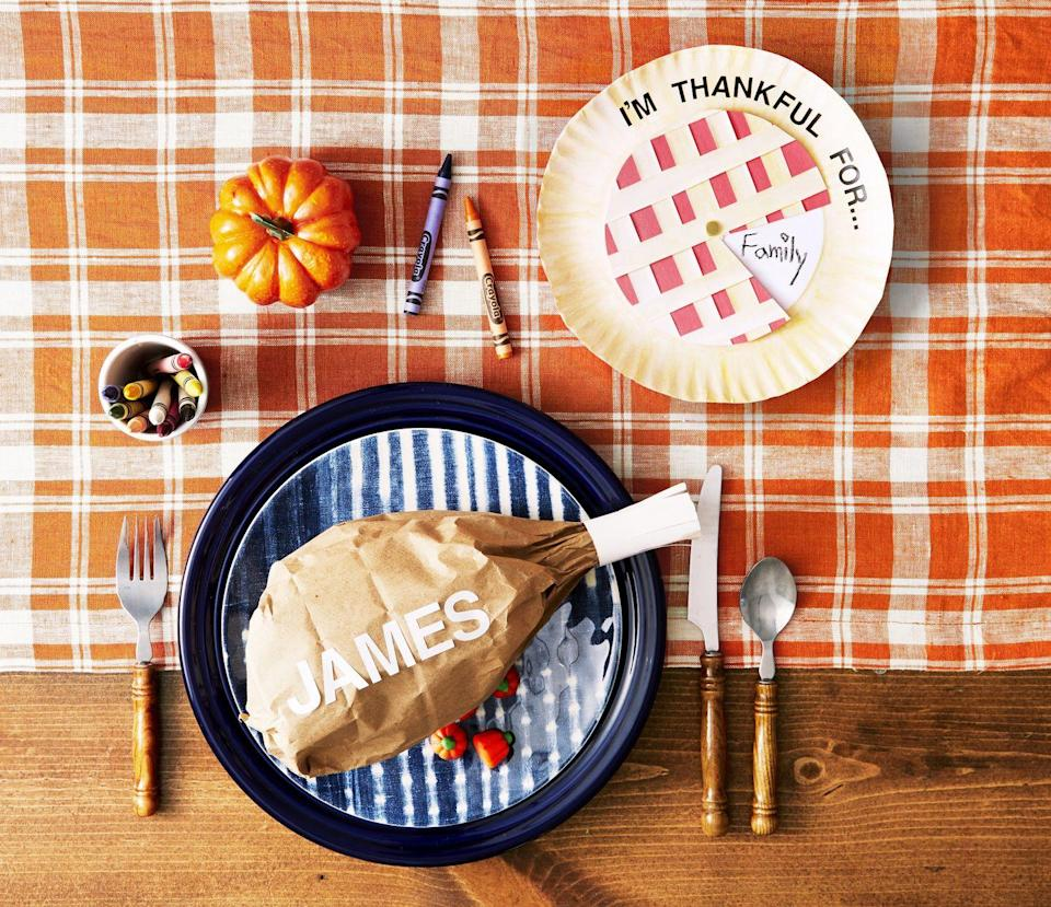 """<p>A spinning """"pie"""" chart helps kids pinpoint what they're thankful for. To make, cut out a construction paper circle the same size as the inside of a paper plate. Attach with brass fastener, then remove a """"slice"""" of pie. Write """"I'm Thankful for …"""" along the top and ask them to add responses as they rotate the """"slice"""" around the pie. </p>"""