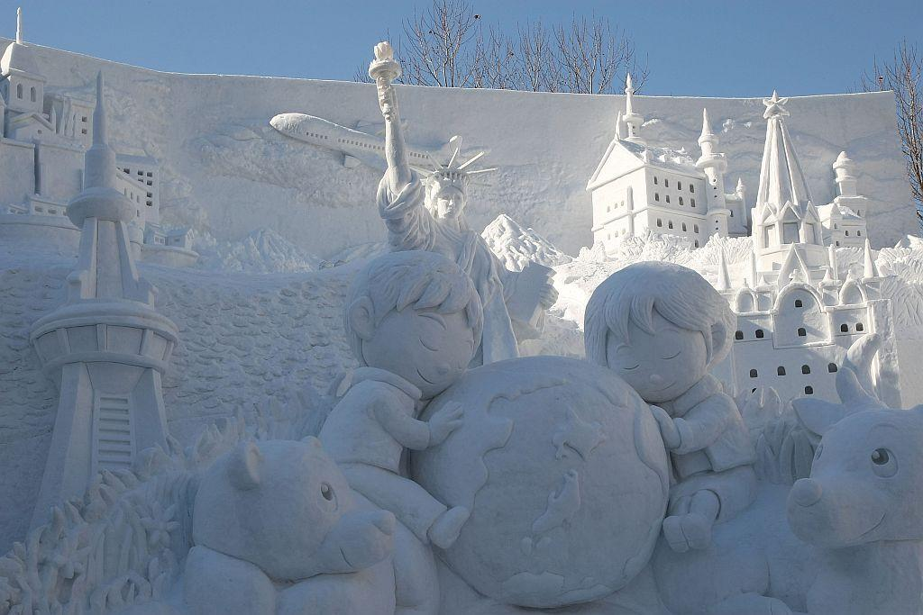 A snow sculpture of the Earth and the Future of Our Children is displayed at Odori Park in Sapporo, Japan.