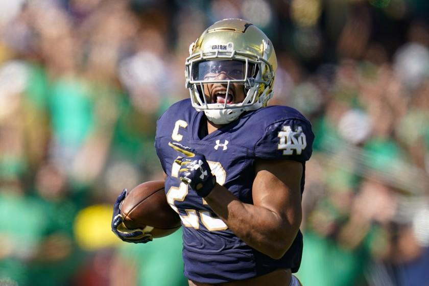 Notre Dame running back Kyren Williams (23) runs in for a touchdown against Purdue during the first half of an NCAA college football game in South Bend, Ind., Saturday, Sept. 18, 2021. (AP Photo/Michael Conroy)