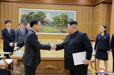 FILE PHOTO: North Korean leader Kim Jong Un shakes hands with Chung Eui-yong who is leading a special delegation of South Korea's President, in this photo released by North Korea's Korean Central News Agency (KCNA) on March 6, 2018. KCNA/via Reuters