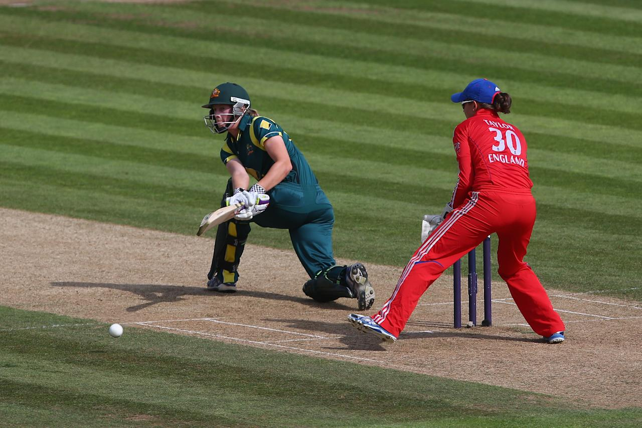 SOUTHAMPTON, ENGLAND - AUGUST 29:  Meg Lanning of Australia hits out during the 2nd England NatWest T20 match between England Women and Australia Women at Ageas Bowl on August 29, 2013 in Southampton, England.  (Photo by Paul Gilham/Getty Images)