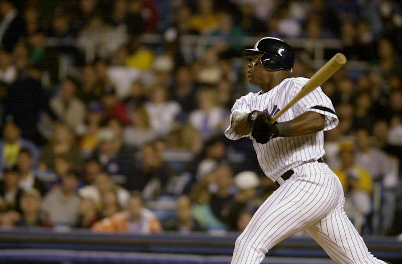 UNITED STATES - CIRCA 2000: New York Yankees' Glenallen Hill hits his second homerun against the Anaheim Angels during game at Yankee Stadium. The Angels won, 9-8. (Photo by Howard Earl Simmons/NY Daily News Archive via Getty Images)