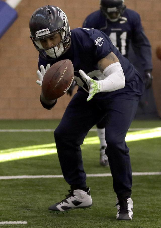 Seattle Seahawks safety Earl Thomas warms up at the start of NFL football practice Thursday, Jan. 30, 2014, in East Rutherford, N.J. The Seahawks and the Denver Broncos are scheduled to play in the Super Bowl XLVIII football game Sunday, Feb. 2, 2014. (AP Photo)