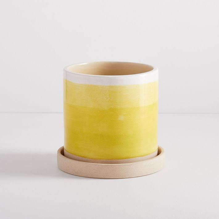 <p>Yellow is one of the Pantone 2021 colors, and the bright hue adds a little sunshine into our everyday lives. There are a bunch of different ways to incorporate yellow, be it cute accessories or home decor, like these <span>West Elm Sketchbook Indoor/Outdoor Planters</span> ($40).</p>