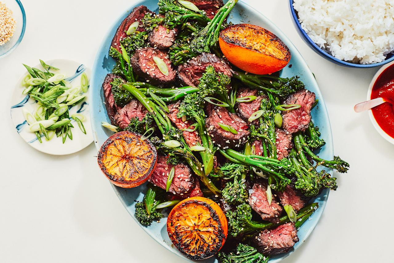 """The secret to the deep orange flavor in this simple weeknight dinner is to sear halved oranges next to the steak as it cooks, and then squeeze the caramelized juice all over your plate before digging in. <a href=""""https://www.epicurious.com/recipes/food/views/chinese-five-spice-steak-with-oranges-and-sesame-broccolini?mbid=synd_yahoo_rss"""">See recipe.</a>"""