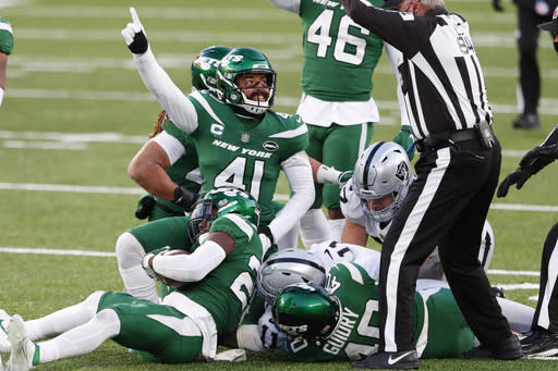 New York Jets' Matthias Farley (41), center, reacts after a fumble recovery during the second half an NFL football game against the Las Vegas Raiders, Sunday, Dec. 6, 2020, in East Rutherford, N.J. (AP Photo/Noah K. Murray)