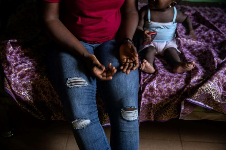 """Human Rights Watch says returnees face """"continuing anguish"""", such as long-term mental and physical health problems and social stigma on returning to Nigeria (AFP Photo/FATI ABUBAKAR)"""
