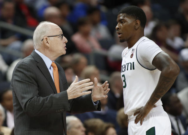 Miami head coach Jim Larranaga, left, talks with Anthony Lawrence II (3) during the first half of an NCAA college basketball game against Wake Forest in the Atlantic Coast Conference tournament in Charlotte, N.C., Tuesday, March 12, 2019. (AP Photo/Nell Redmond)