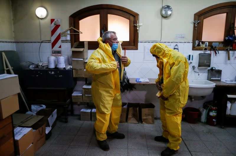 FILE PHOTO: Gravediggers work as Argentine coronavirus death toll mounts amid a deadly second wave of infections