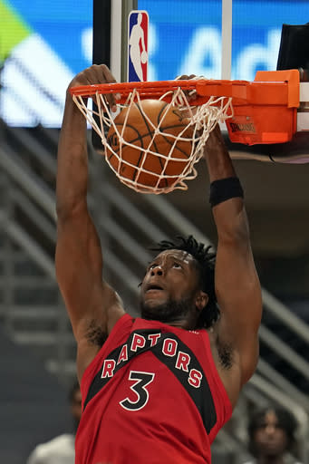 Toronto Raptors forward OG Anunoby (3) dunks the ball against the New Orleans Pelicans during the second half of an NBA basketball game Wednesday, Dec. 23, 2020, in Tampa, Fla. (AP Photo/Chris O'Meara)