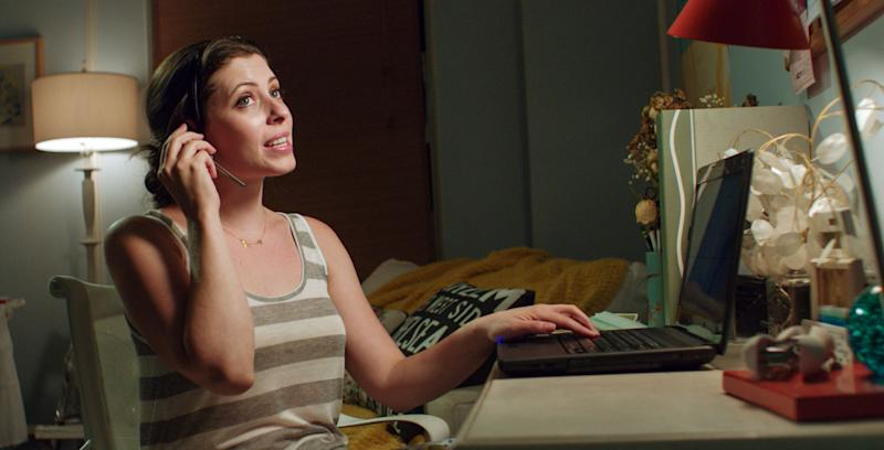 """This film image released by Focus Features shows Lauren Miller in a scene from """"For A Good Time, Call.""""  In the film, roommates played by Lauren Miller and Ari Graynor start a phone-sex company in their New York City apartment.  (AP Photo/Focus Features)"""