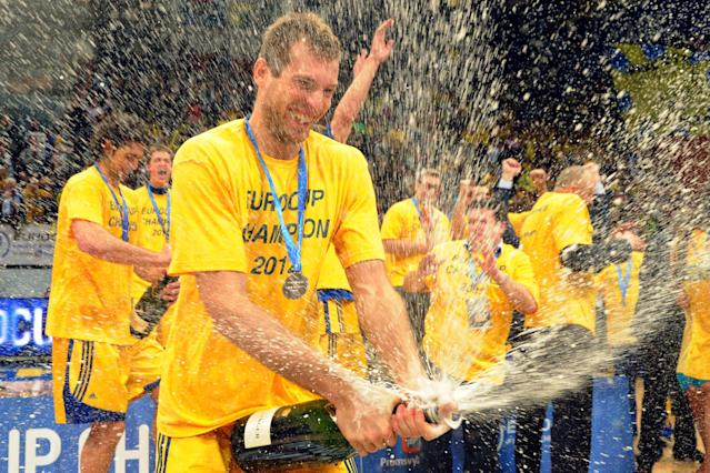 BC Khimki's players celebrate after winning the Eurocup final basketball match between BC Khimki and Valencia in Khimki, outside Moscow on April 15, 2012. BC Khimki won 77-68. AFP PHOTO / KIRILL KUDRYAVTSEV (Photo credit should read KIRILL KUDRYAVTSEV/AFP/Getty Images)