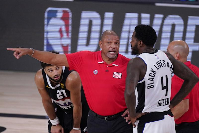 Los Angeles Clippers' Doc Rivers, center, talks with JaMychal Green (4) during the first half of an NBA conference semifinal playoff basketball game against the Denver Nuggets Sunday, Sept. 13, 2020, in Lake Buena Vista, Fla. (AP Photo/Mark J. Terrill)