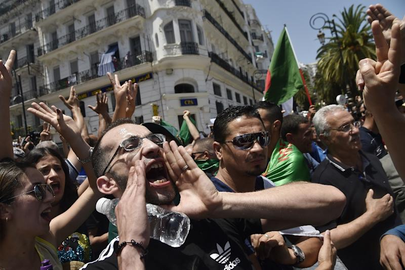 Algerian protesters shout anti-regime slogans during the weekly Friday demonstration in the capital Algiers (AFP Photo/RYAD KRAMDI                        )