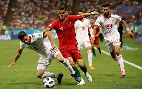 Andre Silva of Portugal is challenged by Ramin Rezaeian and Morteza Pouraliganji of Iran during the 2018 FIFA World Cup Russia group B match between Iran and Portugal at Mordovia Arena on June 25, 2018 in Saransk, Russia - Credit: Getty Images