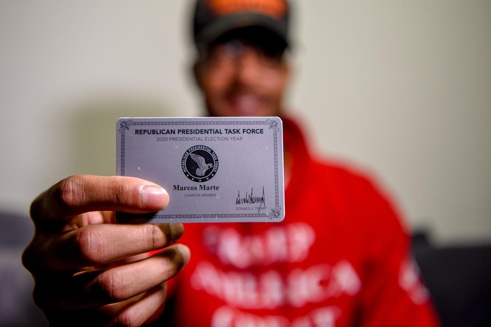 Marcos Marte is a former Bernie Sanders supporter, but now backs Donald Trump for the 2020 election. Marte likes Trump's stance on immigration and the economy and feels he is good for the Latino community. Marte holds up his Republican Presidential Task Force card for a photo in Union City on Oct. 13.