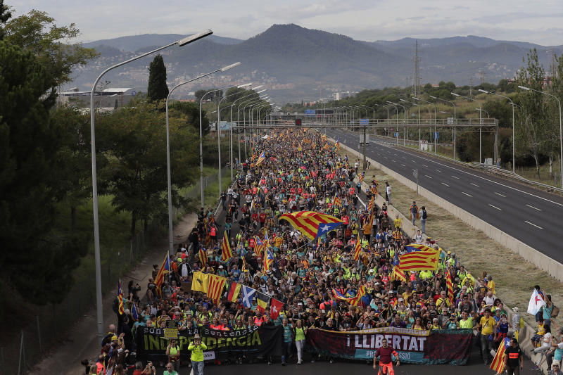 Protesters match into the city on the fifth day of protests over the conviction of a dozen Catalan independence leaders in Barcelona, Spain, Friday, Oct. 18, 2019. Various flights into and out of the region are cancelled Friday due to a general strike called by pro-independence unions and five marches of tens of thousands from inland towns are expected converge in Barcelona's center on Friday afternoon for a mass protest with students to and workers who are on strike. (AP Photo/Manu Fernandez)