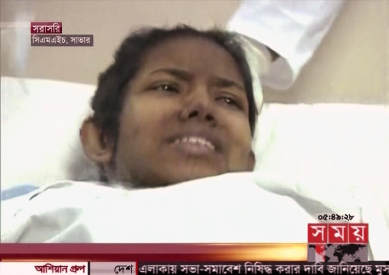 In this image taken from a TV footage released by AP video, a woman survivor lies down on a hospital bed in Dhaka as she was rescued out of a collapsed building in Savar near Dhaka, Bangladesh, Friday, May 10, 2013. The woman buried in the wreckage of a collapsed garment factory building for 17 days was rescued Friday, a miraculous moment set against a scene of unimaginable horror where the death toll is more than 1,000 and still rising. (AP Photo/Somoy TV via AP Video) BANGLADESH OUT