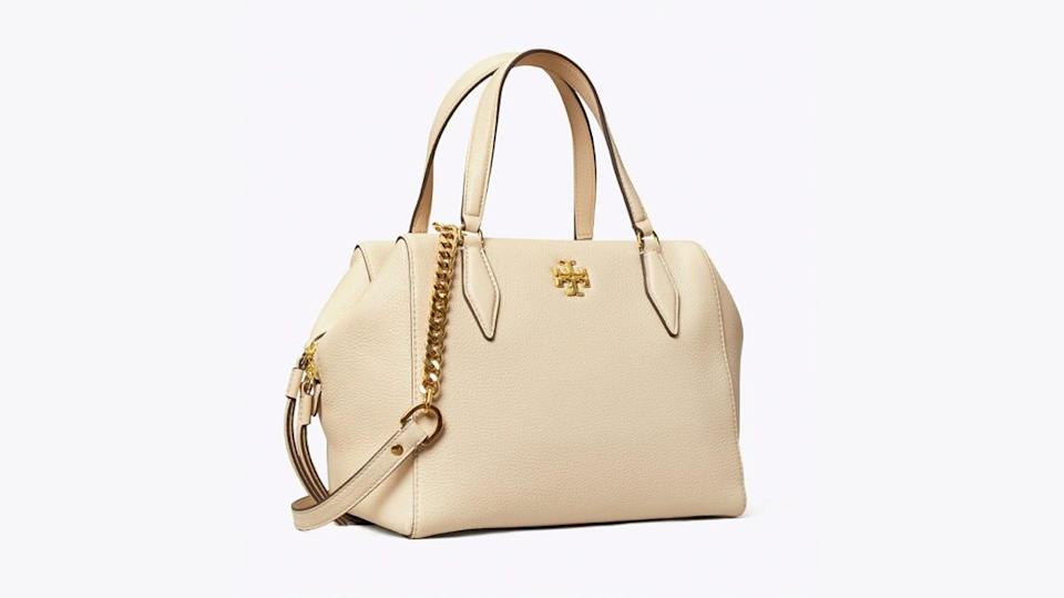 This white-and-gold satchel features top-quality pebbled leather.