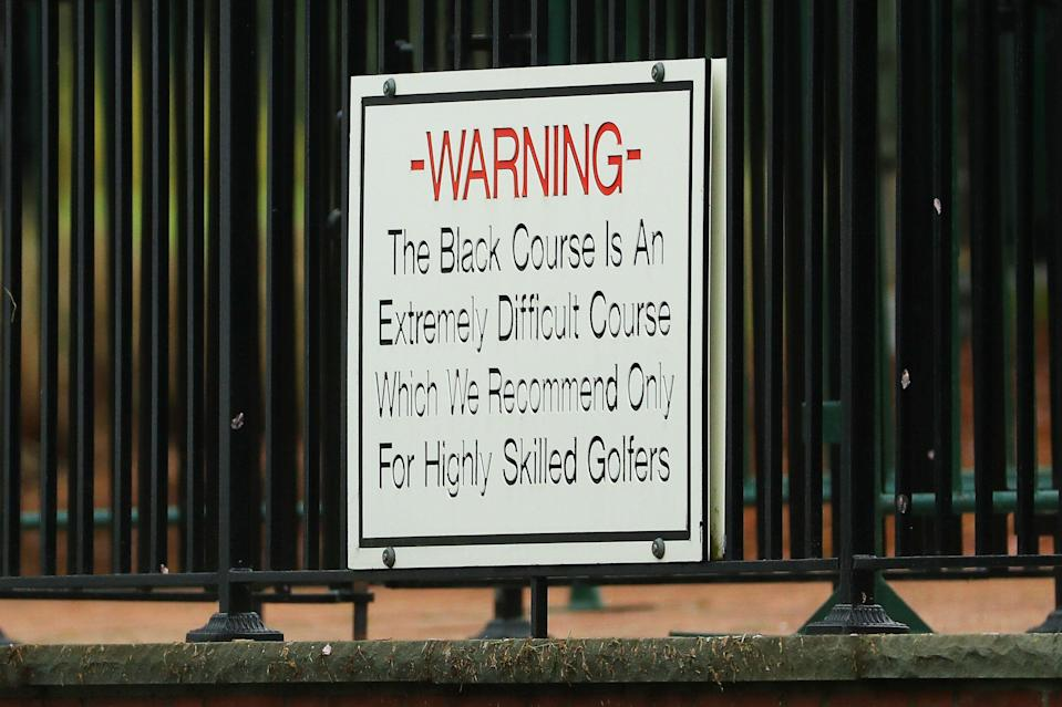 """BETHPAGE, NEW YORK - MAY 14: A """"Warning"""" sign is seen during a practice round prior to the 2019 PGA Championship at the Bethpage Black course on May 14, 2019 in Bethpage, New York. (Photo by Mike Ehrmann/Getty Images)"""