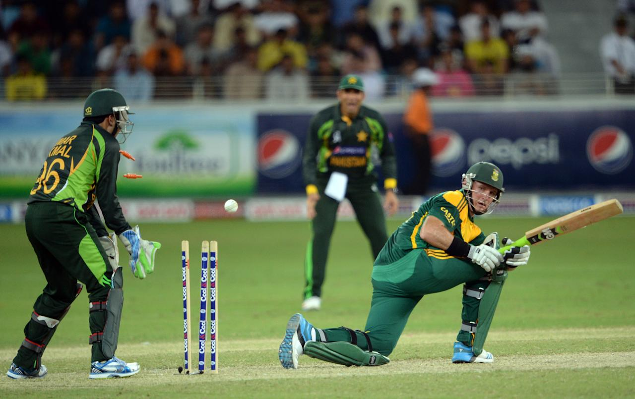 South African batsman Graeme Smith is clean bowled of Pakistani bowler Saeed Ajmal (unseen)  during the second day-night international against South Africa in Dubai Cricket Stadium in Dubai on November 1, 2013. Pakistan's were bowled out for 209 in their innings. South Africa lead the five-match series 1-0. AFP PHOTO/ Asif HASSAN        (Photo credit should read ASIF HASSAN/AFP/Getty Images)